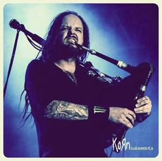 Jonathan & his sexy as hell bagpipes! He's only 1 hard rock that uses bagpipes which mean J.D. is real deal & is can rock wickedly awesome! HOPE I GET TO UR UP FRONT WHERE U CALL BE A HERO! Thanx. But this skitshied