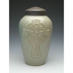 Our Celtic Cross Ceramic Cremation Urn is handcrafted with a gorgeous Celtic-style Christian Cross to honor your loved one's faith. Celtic Christianity, Burial Urns, Memorial Urns, Memorial Ideas, Funeral Urns, Urn Vase, Cremation Urns, Sympathy Gifts, Ceramic Pottery