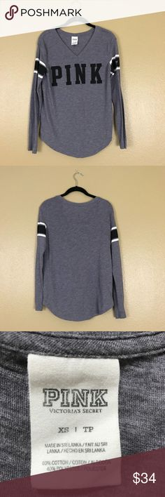 Gray long sleeve shirt from PINK Gray long sleeve v-neck shirt that says PINK on the front.  Black and white trim on the sleeve.  No rips, holes or tears. H PINK Victoria's Secret Tops Tees - Long Sleeve