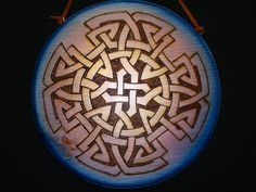 This is a 10 inch round Wood burned Celtic Knot. It is a Celtic Shield designed to protect the owner from all who wish to do them harm. This plaque is stained blue to purple. Celtic Shield, Shield Design, Celtic Knots, Celtic Designs, Nordic Design, Ancestry, Tatoos, Purple, Blue