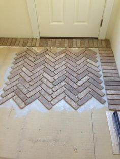 Our Home - Brick Paved Mudroom Floor Brick Paving, Brick Flooring, Diy Flooring, Kitchen Flooring, Herringbone Fireplace, Diy Fireplace, Craftsman Living Rooms, Brick Interior, New Home Construction