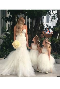 Stunning ivory 'Belle' flower girl dress, ivory sash,French lace, tea length poufy tulle skirt, ivory netting & ivory sash with rhinestone. Ariel Dress, Belle Dress, Couture Wedding Gowns, Couture Dresses, Ivory Flower Girl Dresses, Girls Dresses, Flower Girls, Head To Toe, Corsage
