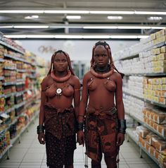 Two women from the Himba tribe shopping at a supermarket in Swakopmund, Namibia, image by London based creative director Toufic Beyhum.