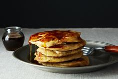 Fruit-Laden, Whole-Grain Pancakes  1 1/4 cup white whole wheat flour 1/3 cup cornmeal 1 tablespoon sugar 2 teaspoons baking powder 1 teaspoon salt 2 large eggs, separated 4 tablespoons butter, melted and cooled 3/4 cups whole millk 1/2 cup yogurt