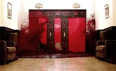 "Visual idea only: White sheet cake with red food coloring and elevator doors. Could also use red candy glass to decorate. Could use graham cracker with white frosting and write ""Redrum"" on it. Chocolate key for room 237"
