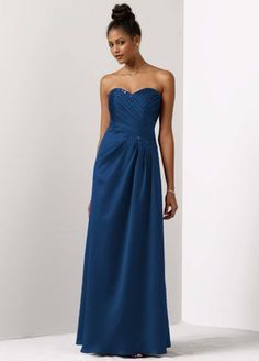 Enchanting and elegant, this classic silhouette has just the right amount of glamour making it a perfect pick for your bridesmaids.   Strapless bodice features beautiful beading and sequin detail along stunning sweetheart neckline.  Side drape and ruching shape a slimming yet structured A-line silhouette.  Fully lined. Back zip. Dry clean only.