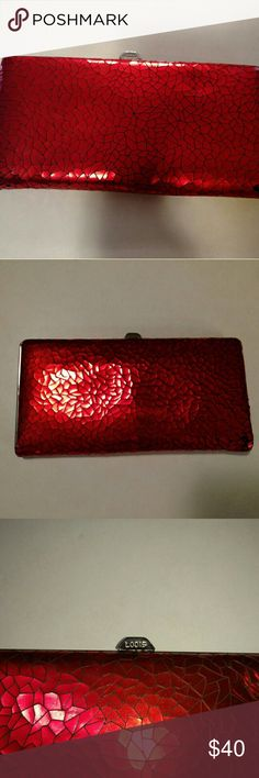 Vintage Lodis shiny red crackled leather wallet Vintage Lodis red shiny crackled leather wallet. Lambskin leather on the inside. Well used. Lodis snap closure. The closure isn't as tight as it use to be but still tight enough. Few red crackles fell off the bottom edges. Slightly off track but by very little, things will not fall out, the space is too small. Gorgeous and rare. Lodis Bags Wallets