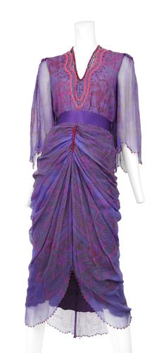 www.resurrectionvintage.com PURPLE CHIFFON BEADED GOWN Zandra Rhodes purple chiffon print gown. Sheer sleeves with bright pink pearl trim. Quilted satin waist band with beautiful chiffon covered buttons.