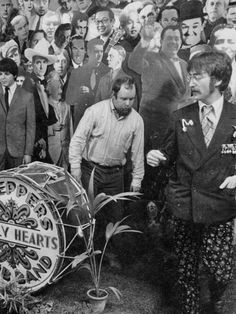 John Lennon on the Sargent Peppers cover photo shoot. Great Bands, Cool Bands, Sound Of Music, My Music, Rock N Roll, The Beatles 1, Beatles Photos, Beatles Sgt Pepper, Beatle Juice