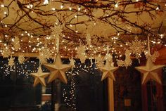 I love this idea at night on the front or back porch. Hang up branches, lights and stars and moons. Putting in a few glass balls to add a little more shine if you want. Invite your friends for a late night dinner or even do this for eating outdoors during Ramadan when your fast is breaking late during the summer time.