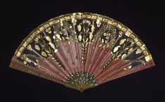 Folding pleated fan, only 17.8 cm tall and 33.6 cm wide, 1805-1810, France via Cooper-Hewitt