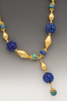 Journey Carved Afghani lapis lazuli beads are complemented by deep blue & bright turquoise-hued azurite beads & gold accents. Jewelry Art, Antique Jewelry, India Jewelry, Gold Jewelry, Beaded Jewelry, Jewelery, Handmade Jewelry, Fashion Jewelry, Beaded Necklace