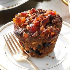 Miniature Christmas Fruitcakes Recipe -I've found that people who normally won't eat fruitcake make an exception when they sample these. Using mini muffin pans for baking creates fun, single-serving cakes. —Libby Over, Phillipsburg, Ohio Christmas Cooking, Christmas Desserts, Christmas Treats, Christmas Fruitcake, Christmas Cakes, Cupcakes, Cupcake Cakes, Fruit Cakes, Single Serve Cake