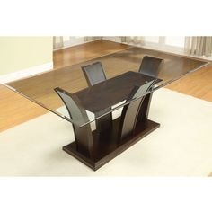 """This gorgeous Gretchen rectangular dining table is perfect for a family of six with an elegant 72 inch beveled glass top that your family will enjoy during every meal.   Dining Table Dimensions: 72"""" L x 42"""" W x 31"""" H; 166 lbs."""