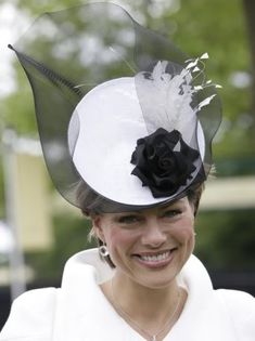 Kate looked lovely in this all white ensemble, with a black and white hat   Fashion Police Files - Royal Ascot 2010