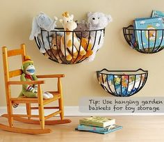 Use hanging garden baskets for toy storage.  I would use the 3M hooks so no holes in the wall and you can move them as needed easily.