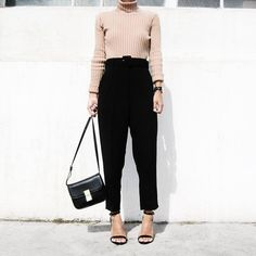 The heels elongate your legs, making this baggy look seem elevated rather than sloppy. Image Source: Instag...