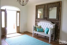 """Entryway Room Makeover complete with sliding wall, """"old"""" vintage doors and refurbished headboard/footboard bench   Design Dazzle"""