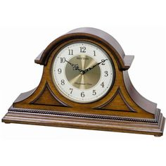 """With the Traditional look of a tambour style mantel clock, The Rhythm Joyful Remington is set off by the two raised accent panels on the face to enhance the beauty of this model. Beaded moulding on the base with a white dial and antique brass bezel. Our signature musical movement offers 6 Christian Hymns / 16 Popular Melodies / 6 Christmas melodies. Adjust the volume or you may turn off the sound completely. Just flip a switch on the side to change your group selection. Size: H. 11.1"""" W. 18"""""""