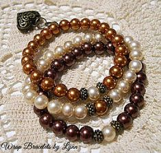 Made with 8mm multi-color imitation glass pearl beads on double thickness .08mm stretch cord with antique bronze charm. Set of 3 bracelets * Will fit 6- 7 wrist