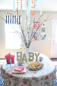 """You've probably heard that throwing a shower for someone's second baby is often referred to as a """"sprinkle"""". I decided to run with that theme for my friend's baby girl shower."""