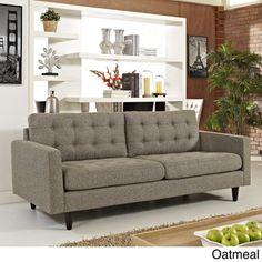 @Overstock - Empress Oatmeal Upholstered Sofa - Empress is heralded with deeply tufted buttons, plush cushions and armrests that convey that perfect air of luxury and comfort.  http://www.overstock.com/Home-Garden/Empress-Oatmeal-Upholstered-Sofa/8704927/product.html?CID=214117 $784.99