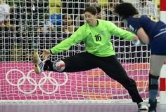 Croatia's goalkeeper Ivana Jelcic tries to make a save during the women's quarter-final handball match Spain vs Croatia for the London 2012 Olympics Games on August 7, 2012 at the Copper Box hall in London. Spain won 25-22.