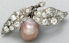 A diminutive Edwardian diamond and pink pearl brooch set as a pear in diamond and platinum leaves +