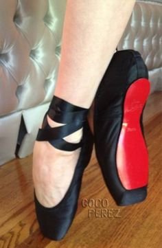 Dita Von Teese's custom Christian Louboutin red soled pointe shoes for the west coast leg of her tour.