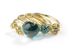 Ring by Whitireia jewellery graduate Stacey Whale: Atomic Beauty - Encapsulated Raindrop and Natural Instinct Rings - 18ct gold, enhanced blue diamonds and transparent blue topaz spheres .