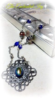 Romantic Vintage Victorian Style Glass Aurora Borealis Cabochon Pendant Necklace by TheEnchantedIvy on Etsy