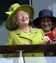 "The Sun:  Arthur Edwards Royal photos-The Queen has a giggle at the Derby  Arthur explains: ""The Queen is often seen in formal poses so I love this shot, from 2002, which shows her throwing her head back laughing in an unguarded moment."""