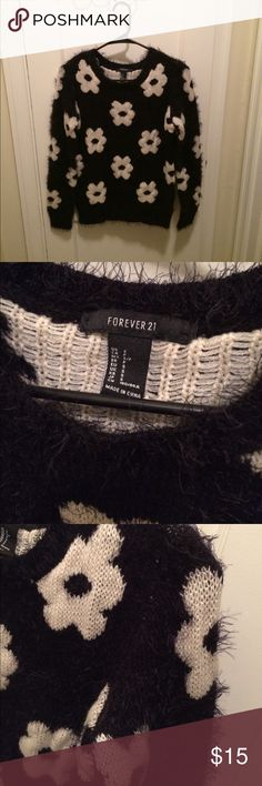 Fuzzy Forever 21 Flowered Sweater Small, black and white soft sweater. Plush and fun. Has original washing tag instructions because never worn. Acrylic, Nylon. Please note this is a hand wash only piece/ or dry clean. A cozy piece! Forever 21 Sweaters