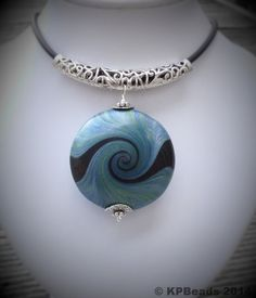 Polymer clay swirl pendant necklace by KPBeads