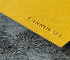 Business Cards printed for Carrousel Agency London - Printed by: www.dot-studio.org  -  Printing:   Side A Blind Embossing   Side B Black foil blocking  -  Paper:  side A 175gsm GF Smith Colorplan Citrine  side B 240 + 240gsm Munken Kristall  Finishing:  Duplex + Foil blocking + Embossing