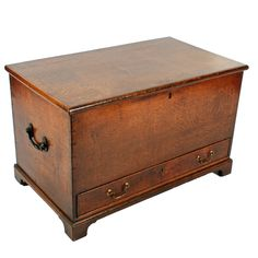 Small Georgian Oak Mule Chest   A small late 18th to early 19th century Georgian oak mule chest.  The chest has a hinged lid with a rounded mould to the edge and a single drawer.  The interior has a candle box to the left hand side with a hidden compartment holding two drawers.  The base of the chest holds the slim full length drawer that has a cock beaded edge, pine linings and brass swan neck handles.  The chest stands on shaped bracket feet and has carrying handles to each side.  The chest  Storage Boxes, Storage Chest, Antique Bedroom Furniture, Candle Box, Antique Boxes, Colour Schemes, Georgian, 19th Century, Drawers