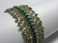 Hand Bracelet, Crochet Knitting, 7 lines of Glass beads, Green and Turquoise Beads, Gold, Hand Made, Gold Plated rings and Clasps.