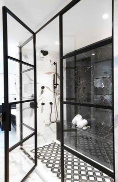 A black marble wall matched a black marble shower bench fixed against black and white mosaic floor tiles, as a matte black shower kit contrasts white and gray marble wall tiles. Black Marble Tile, Black Marble Bathroom, Black And White Marble, Marble Wall, Marble Tiles, Wall Tiles, Bathroom Accent Wall, Bathroom Accents, Shower Floor Tile