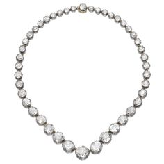 PROPERTY OF A BRITISH NOBLE FAMILY: Diamond rivière, mid-19th century. Composed of a graduated line of pinched collet-set cushion-shaped and circular-cut diamonds.