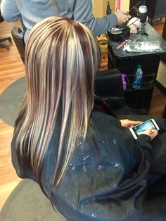Mocha brown underneath with red violet and blonde chunky highlight on top
