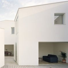 Two holiday homes by French architects RAUM in Brittany, France, built around courtyards that are connected by small alleys.