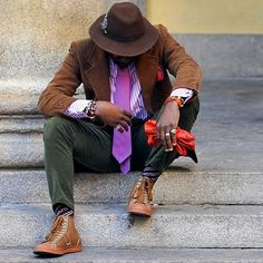 Wear a brown corduroy blazer jacket and olive cord pants for a dapper casual get-up. For a more relaxed take, make camel leather high top sneakers your footwear choice.   Shop this look on Lookastic: https://lookastic.com/men/looks/blazer-dress-shirt-chinos/23462   — Dark Brown Wool Hat  — Violet Vertical Striped Dress Shirt  — Red Polka Dot Pocket Square  — Orange Leather Watch  — Violet Bracelet  — Red Leather Gloves  — Violet Tie  — Brown Corduroy Blazer  — Olive Corduroy Chinos  — Tan…