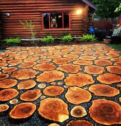 So we had to cut a very large tree down, so instead of turning it into fire wood we turned it into a patio. We love it. We used 3-4 inch slabs of western red cedar, laid on a base of rock and sand, with 1/2 inch crushed rock in between. Enjoy.