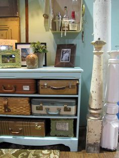 Vintage suitcases on painted bookcase - by The Painted Home