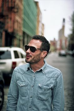 i love men in jean/chambray shirts.  p.s. even though the background is blurry, i assure you there is no way that's not NYC