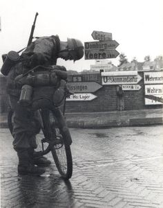 A German soldier loading up his gear onto a bicycle. As the war drug on, horses & bicycles were used more & more by the Axis powers as fuel ran scarce..