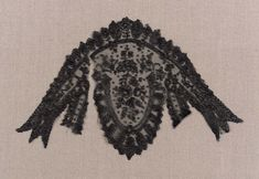 Woman's small black lace cap, French (Chantilly) mid-19th century  | Museum of Fine Arts, Boston