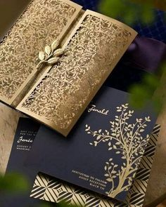 Navy Blue and Gold Laser Cut Wedding Invitations / http://www.deerpearlflowers.com/navy-blue-and-gold-wedding-color-ideas/