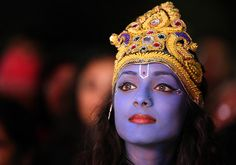 Diwali: A dancer waits to perform on stage as Lord Krishna in Leicester