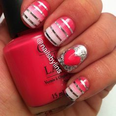 Lots going on here:  dark pink to white gradient with silver striping tape accents, AND an accent nail of a pink heart over a silver foil background!